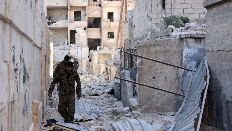 Syrian pro-government forces inspect the Masaken Hanano district in eastern Aleppo, a day after they resized it from rebels.