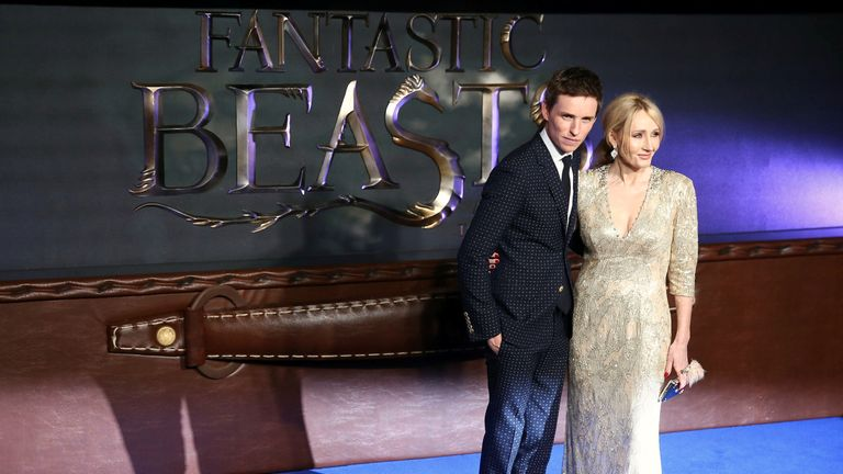 Eddie Redmayne poses with writer JK Rowling as they arrive for the European premiere of Fantastic Beasts and Where to Find Them at Cineworld Imax, Leicester Square