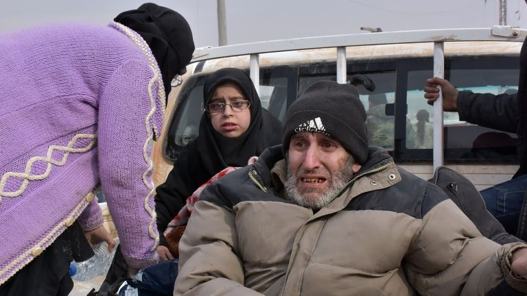 Syrian families, fleeing from various eastern districts of Aleppo, wait to board vehicles on November 29, 2016 in the government-held eastern neighbourhood of Jabal Badro, before heading to government-controlled western Aleppo, as the Syrian government offensive to recapture rebel-held Aleppo has prompted an exodus of civilians. The Syrian government offensive to recapture rebel-held Aleppo sparked international alarm, with the UN saying nearly 16,000 people had fled the assault and more could f
