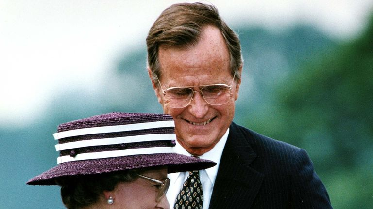 US President George Bush steps aside 14 May 1991 for Great Britain's Queen Elizabeth II to address the crowd attending a welcoming ceremony at the White House, in Washington, DC. During his remarks, President Bush addressed the queen, saying, 'You have been freedom's friend for as long as we remember.' (Photo credit should read JEROME DELAY/AFP/Getty Images)