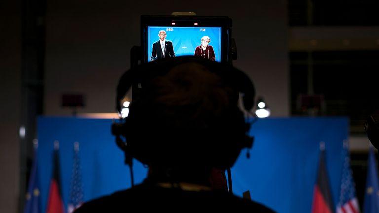 Barack Obama and Angela Merkel appear together at a media conference