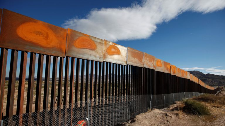 A U.S. worker inspects a section of the U.S.-Mexico border wall at Sunland Park, US