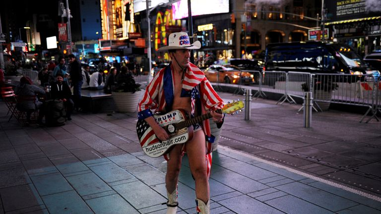 """A """"Naked Cowboy"""" performer supporting Donald Trump walks through Times Square in New York"""