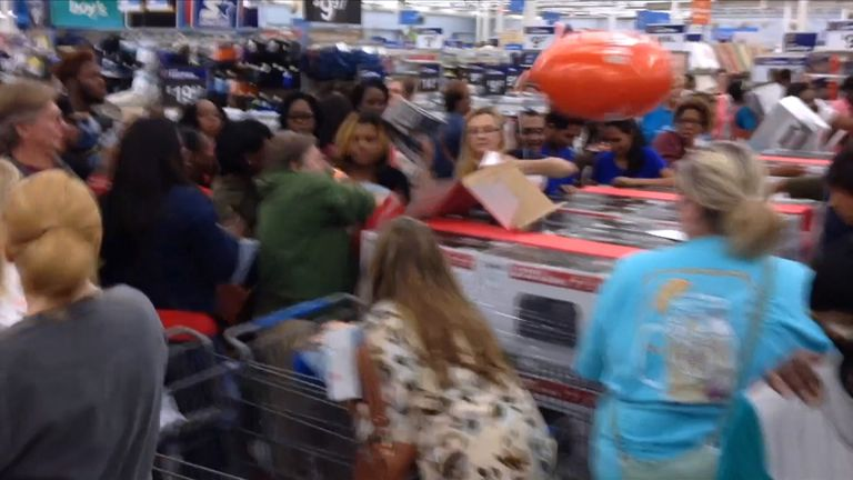 Shoppers appear to be fighting over goods on Black Friday. Pic: YouTube/Kelly Tippett