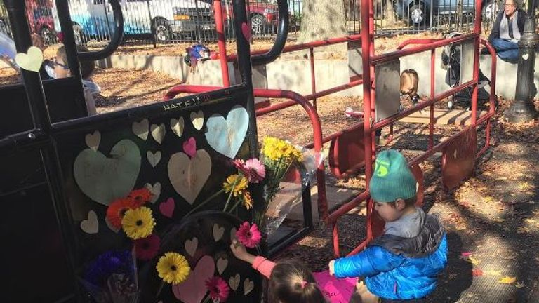 Children re-decorate Adam Yauch Park in New York after it was sprayed with swastika graffiti