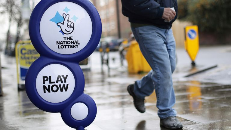 A National Lottery sign outside a newsagent. File picture
