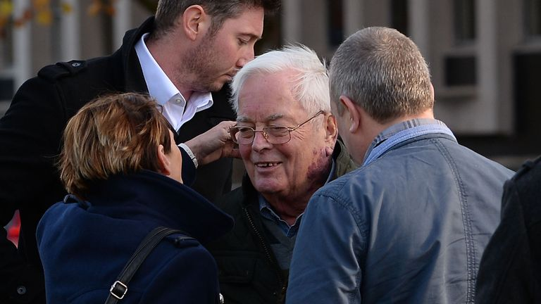 The 79-year-old is greeted by family members outside court