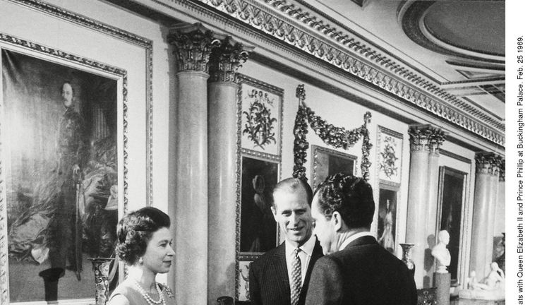 President Nixon chats with Queen Elizabeth II and Prince Phillip at Buckingham Palace. Feb. 25 1969. 1969