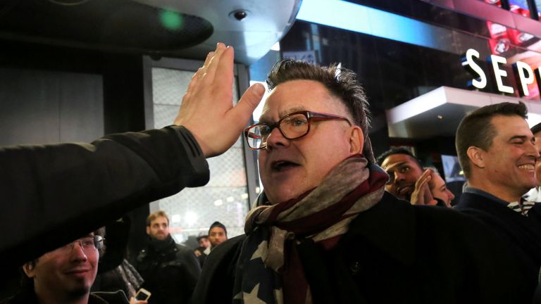 A supporter of U.S. President-elect Donald Trump argues with a man against Trump in Times Square, New York