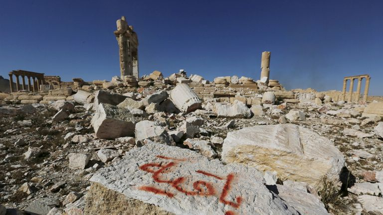 """IS graffiti reads """"we remain"""" after Syrian troops recapture the ancient site of Palmyra"""