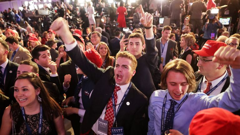 People cheer as voting results for Florida come in at Donald Trump''s election night event at the New York Hilton Midtown