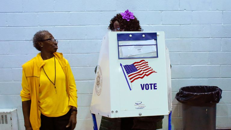 A voter asks an election worker a question as she votes at Samuels Community Center in the presidential election November 8, 2016 in the Harlem neighborhood of New York City. / AFP / KENA BETANCUR (Photo credit should read KENA BETANCUR/AFP/Getty Images)