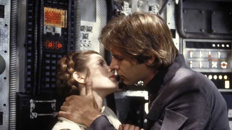 Carrie Fisher and Harrison Ford kiss in a scene from The Empire Strikes Back