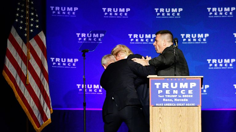 Donald Trump is hustled off the stage by security agents after a perceived threat in the crowd, at a campaign rally in Reno, Nevada
