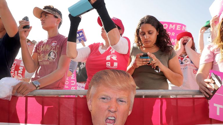 Supporters listen to Republican presidential nominee Donald Trump during a campaign rally the Orlando Amphitheater at Central Florida Fairgrounds