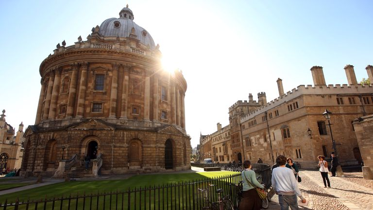 OXFORD, ENGLAND - OCTOBER 08: Students walk through Oxford city centre as Oxford University commences its academic year on October 8, 2009 in Oxford, England.