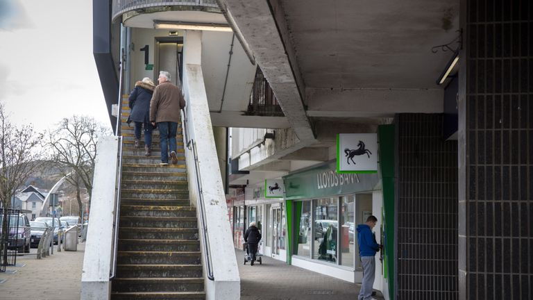 EBBW VALE, UNITED KINGDOM - MARCH 07: People walk along the high street in Ebbw Vale on March 7, 2016 in Blaenau Gwent, Wales. The West Wales and the Valleys region,