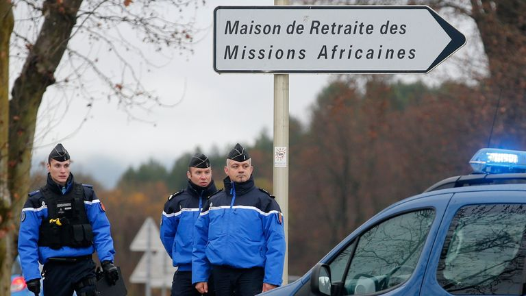 Police stand guard near the retirement home