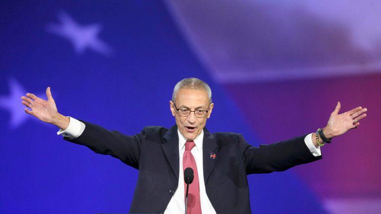 Hillary Clinton's campaign chairman John Podesta addresses supporters