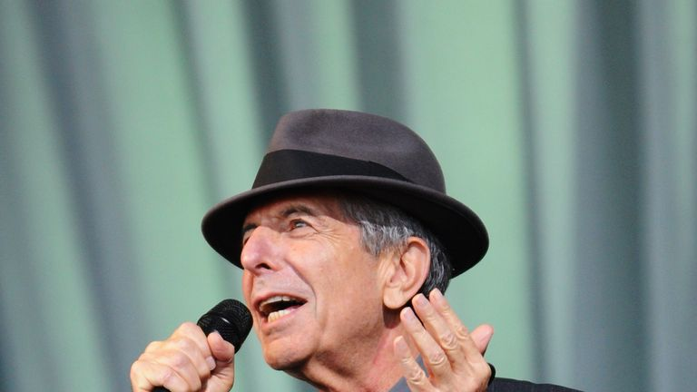 Leonard Cohen performs on  the Pyramid stage at Glastonbury in 2008