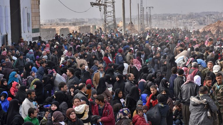 Syrian families, fleeing from various eastern districts of Aleppo, queue to get onto governmental buses on November 29, 2016 in the government-held eastern neighbourhood of Jabal Badro, before heading to government-controlled western Aleppo, as the Syrian government offensive to recapture rebel-held Aleppo has prompted an exodus of civilians. The Syrian government offensive to recapture rebel-held Aleppo sparked international alarm, with the UN saying nearly 16,000 people had fled the assault an