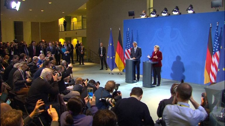 Angela Merkel speaks beside Barack Obama on his final European tour