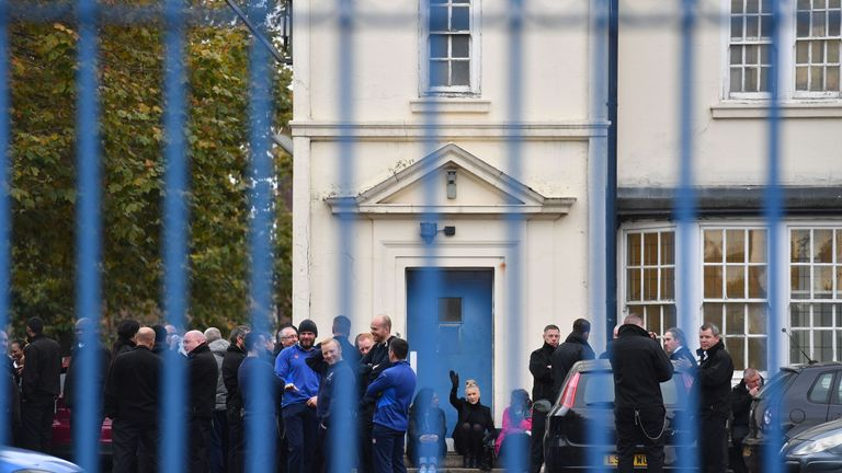 Members of the prison service gather outside HM Prison Pentonville in north London on November 15, 2016 after prison officers stopped work in protest over conditions in prisons.