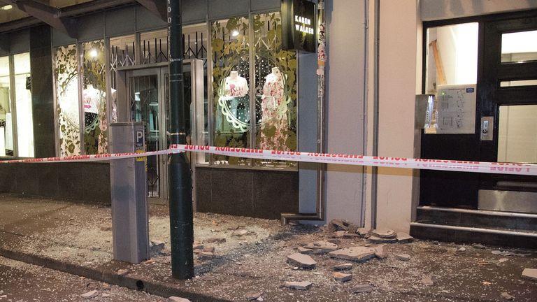 Debris from buildings on a sidewalk past a cordon line in Wellington e
