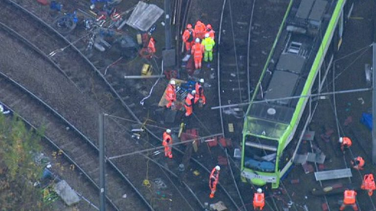 Accident investigators pick through the wreckage