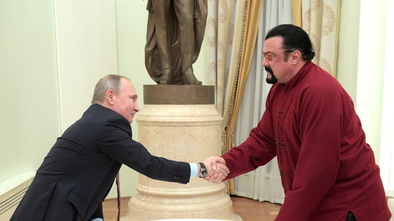 Russian President Vladimir Putin (L) shakes hands with US action hero actor Steven Seagal after presenting a Russian passport to him during a meeting at the Kremlin in Moscow on November 25, 2016. / AFP / SPUTNIK / Alexey DRUZHININ (Photo credit should read ALEXEY DRUZHININ/AFP/Getty Images)