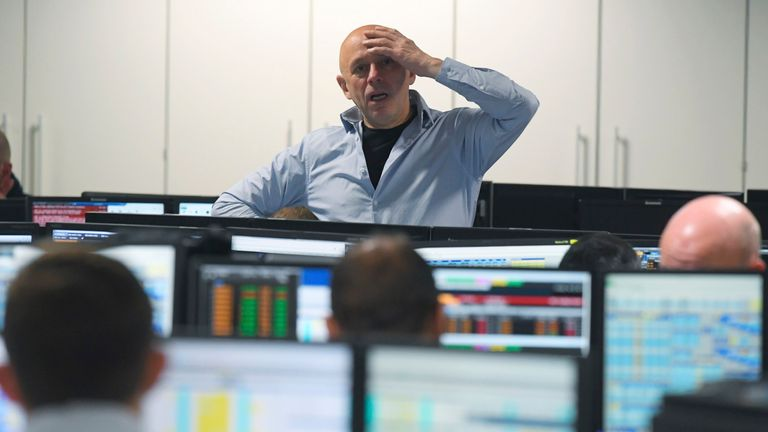 Traders at BGC Partners look at screens after Donald Trump won the U.S. Presidential election, in London