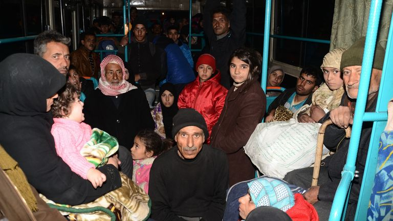 Syrian families are evacuated through Sheikh Maqsud, a Kurdish-controlled enclave between east and west Aleppo