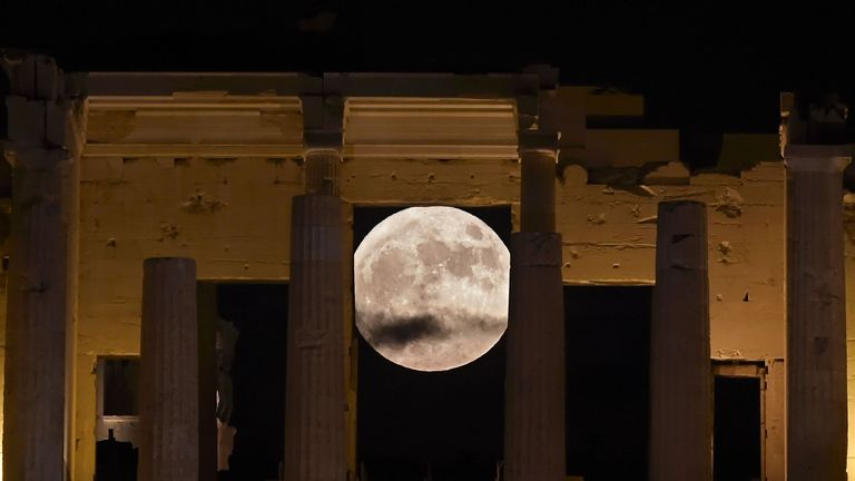 The 'Supermoon' rises behind the Propylaea in Athens