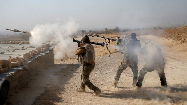 An Iraqi soldier fires a RPG during clashes with Islamic State fighters in Al Qasar, southeast of Mosul.
