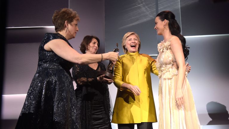 : (L-R) Pamela Fiori, Hillary Clinton, Katy Perry, and Caryl Stern