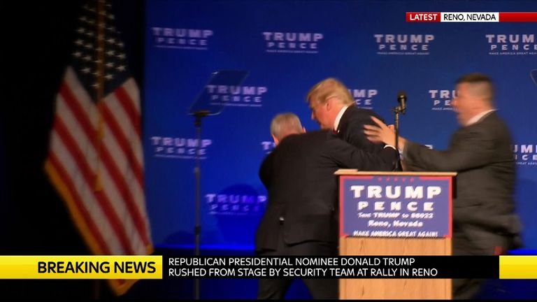 Donald Trump is rushed off the stage by security agents at a rally in Reno