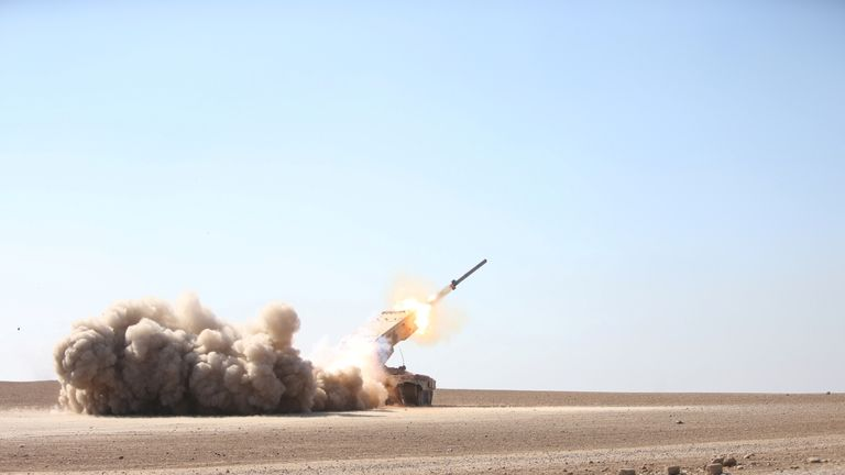 Iraqi security forces launch a rocket towards IS militants in Ali Rash village, southeast of Mosul