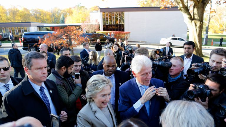 Hillary Clinton greets supporters after casting her vote