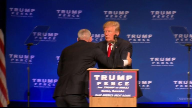 Donald Trump is rushed off stage in Reno, Nevada, after a false gun scare