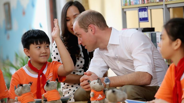 Prince William visits a school in Hanoi during a two-day visit to Vietnam
