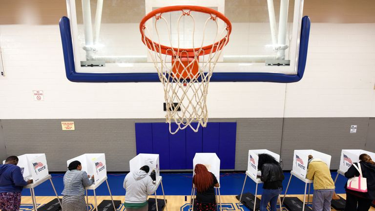 Voters at a polling station on a basketball court in Greenville, North Carolina