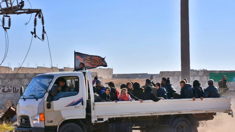 Syrian displaced families arrive at a makeshit camp in the government-held district of Jibreen in Aleppo