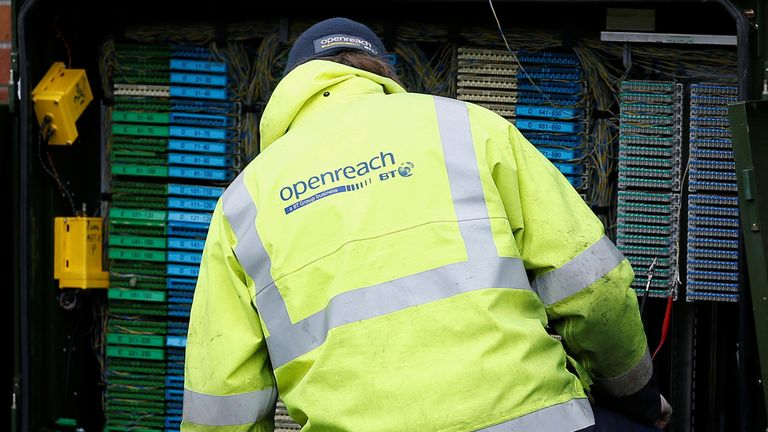 A BT Openreach engineer working on a telecoms cabinet near Manchester