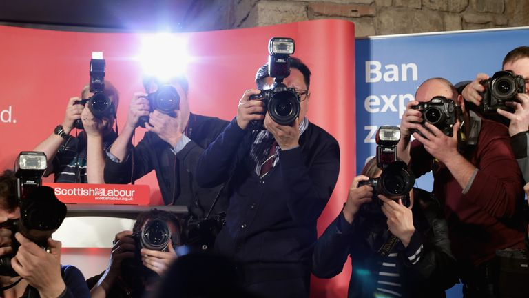 GLASGOW, SCOTLAND - MAY 05: News photographers capture the arrival of Scottish Labour leader Jim Murphy, former Prime Minister Gordon Brown and Shadow Scottish Secretary Margaret Curran during a campaign event at the Lighthouse May 5, 2015 in Glasgow, Scotland,