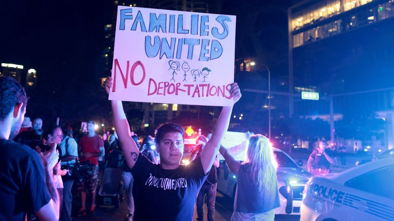 People in Miami also demonstrated against Mr Trump and his policies