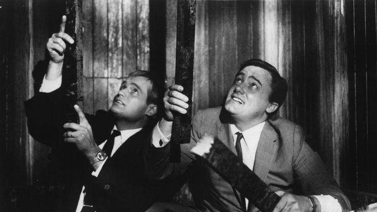 1966: David McCallum (left) as Ilya Kuryakin and Robert Vaughn as Napoleon Solo in a scene from the film 'One Of Our Spies Is Missing', a spin-off from the television series 'The Man From UNCLE'. (Photo by Evening Standard/Getty Images)
