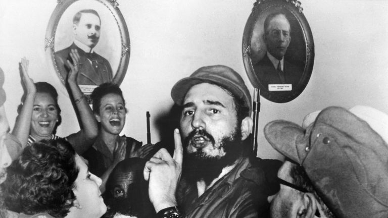Picture dated 1959 of Cuban leader Fidel Castro (C) shortly after toppling dictator Fulgencio Batista