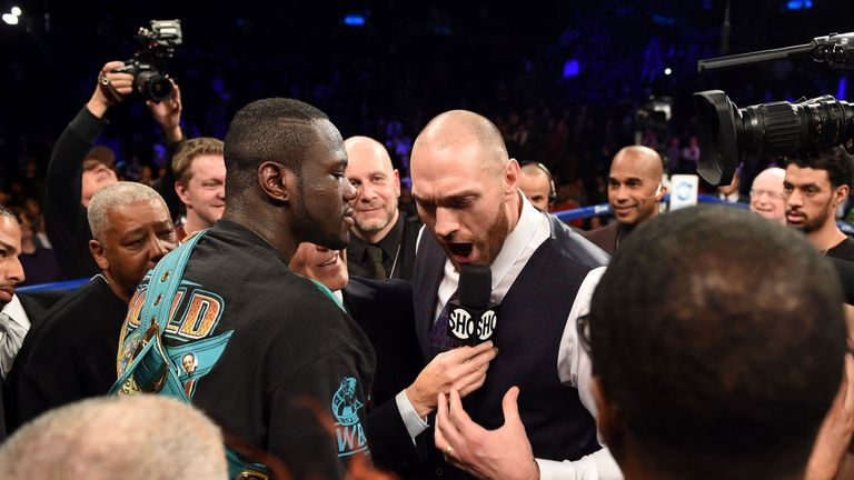 Tyson Fury of Britain (R) challeges Deontay Wilder of the US (L) after Wilder defeated Artur Szpilka of Poland in their WBC Heavyweight Championship bout a
