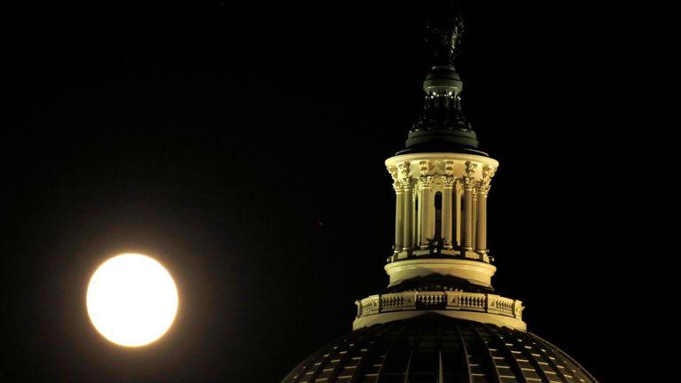 The supermoon rises over the United States Capitol dome in Washington, U.S., November 13, 2016
