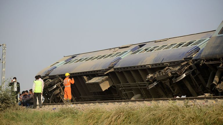 Rescue workers survey the wreckage of the train